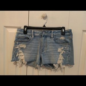 Express jean shorts with lace inlay.